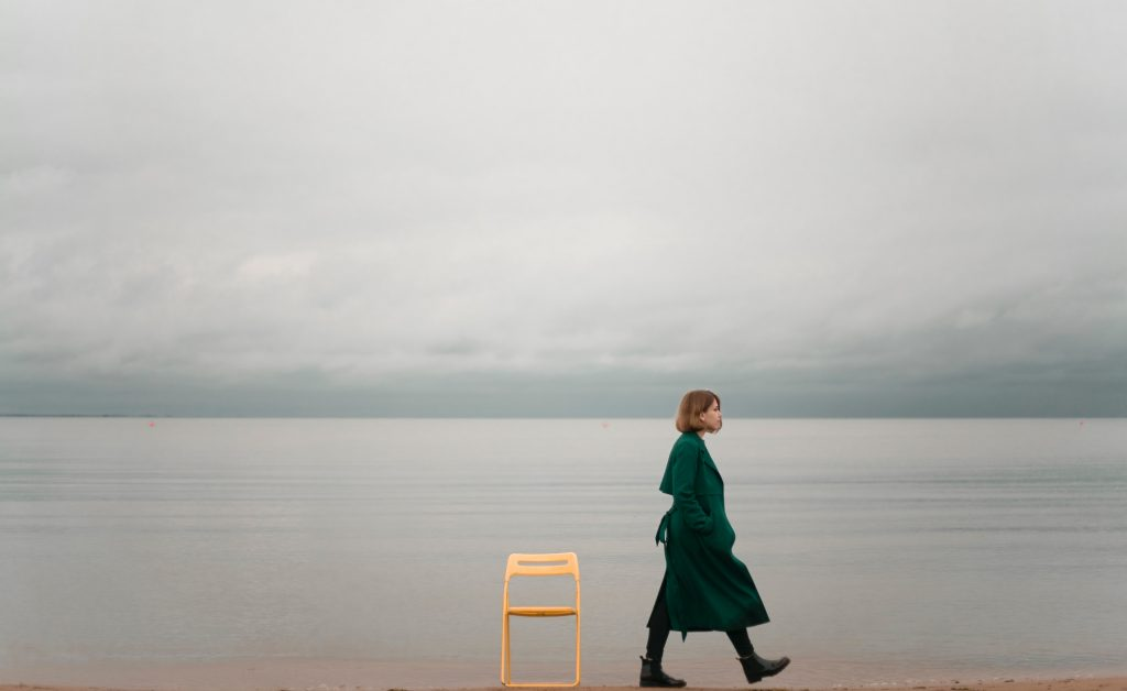 Woman Walking Away From Chair