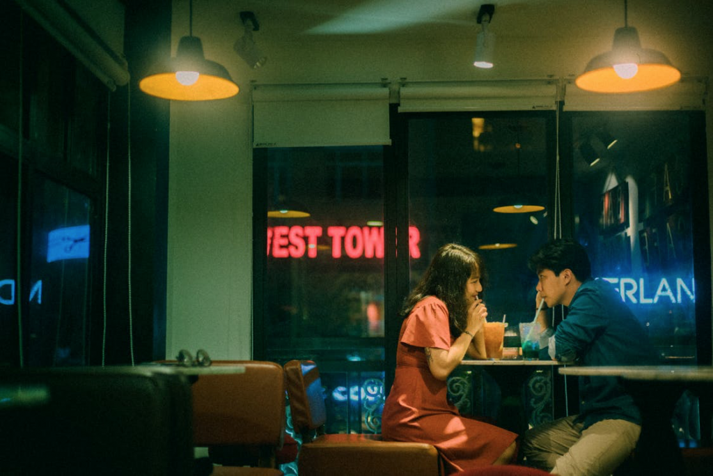 couple drinking retro diner cafe